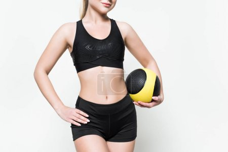 Sportive woman with medicine ball isolated on white