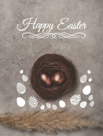 top view of golden easter eggs in nest on concrete surface with Happy Easter lettering
