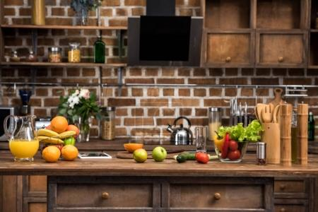 digital tablet, fresh fruits and vegetables on kitchen table
