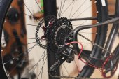 close-up view of bicycle wheel with chain in workshop