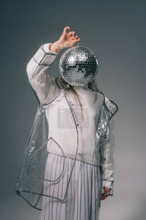 Photo for Obscured view of stylish woman covering face with disco ball isolated on grey - Royalty Free Image