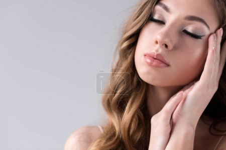 portrait of tender girl with closed eyes, isolated on grey