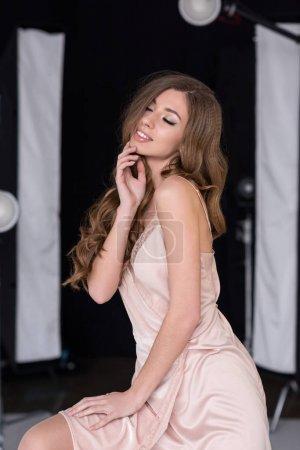 sensual girl posing for fashion shoot in studio
