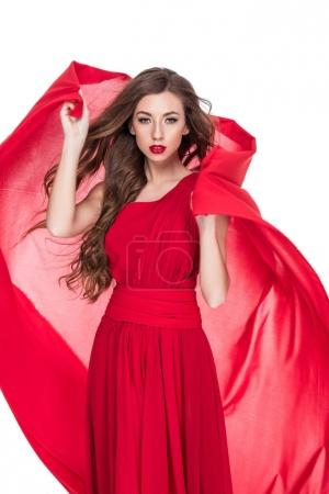 beautiful woman posing with red chiffon veil, isolated on white