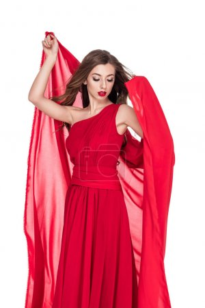 attractive woman posing in red dress with chiffon veil, isolated on white