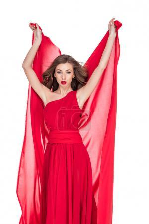 glamorous woman in red posing with chiffon veil, isolated on white