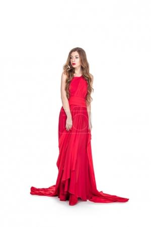 beautiful glamorous woman posing in red dress, isolated on white