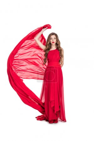 attractive girl posing in red chiffon dress with veil, isolated on white