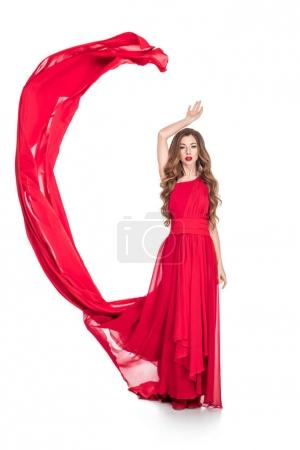 glamorous attractive girl posing in fashionable dress with red veil, isolated on white