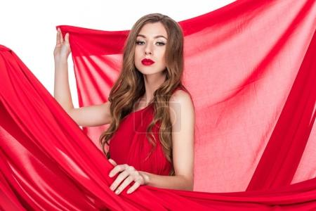 attractive girl posing in red dress with veil, isolated on white