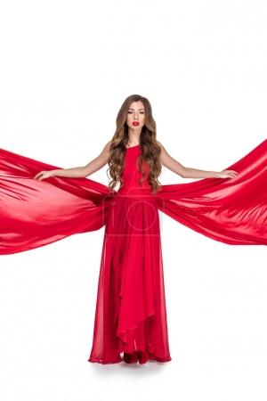glamorous girl posing in red dress, isolated on white
