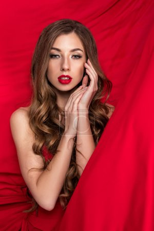 glamorous beautiful woman posing in red