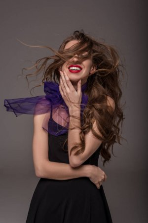 beautiful cheerful girl posing for fashion shoot, isolated on grey