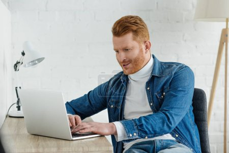 Photo for Young professional man looking at laptop screen - Royalty Free Image