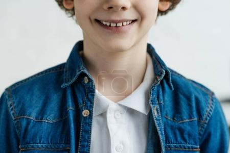 Close-up view of smiling little child wearing shirt and jacket