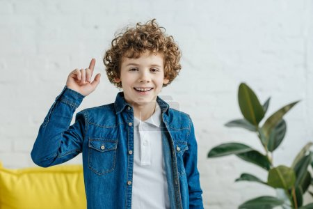 Photo for Child boy having an idea pointing up - Royalty Free Image