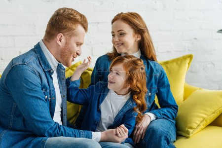 Cute family parents and child embracing at home