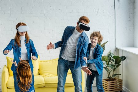 Parents using vr glasses having fun together with their children