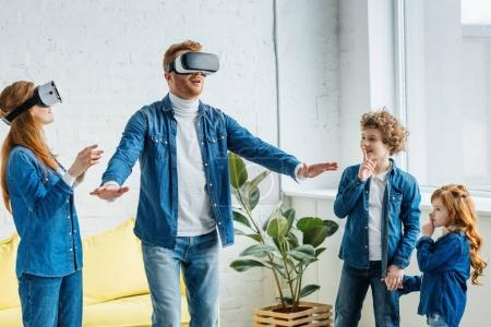 Parents using vr glasses together with their children at home