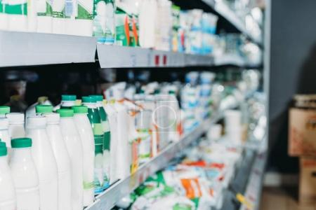 selective focus of dairy products in supermarket