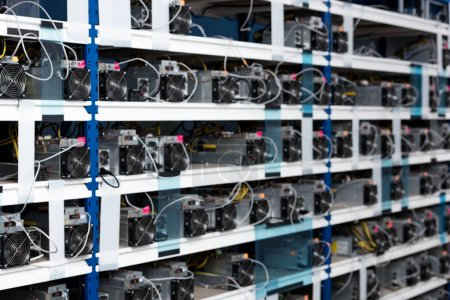 shelves with power supply units for cryptocurrency mining farm