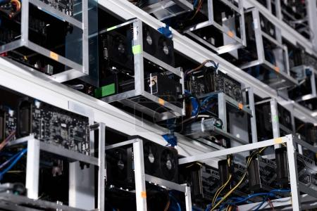 Photo for Bottom view of shelves with equipment at ethereum mining farm - Royalty Free Image