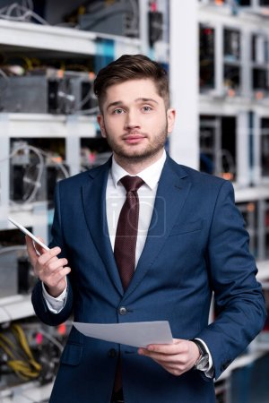 successful young businessman at cryptocurrency mining farm