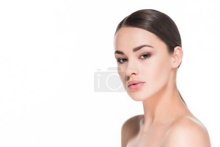attractive young woman with simple makeup looking at camera isolated on white