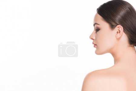 side view of young woman with perfect skin isolated on white