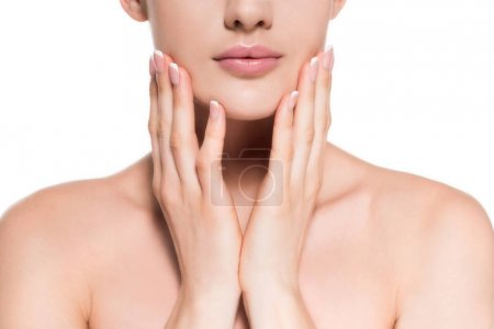 cropped shot of young woman with clear skin touching her face isolated on white