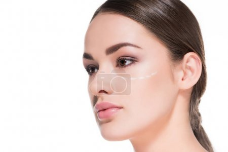 close-up shot of beautiful young woman with dotted line on face isolated on white