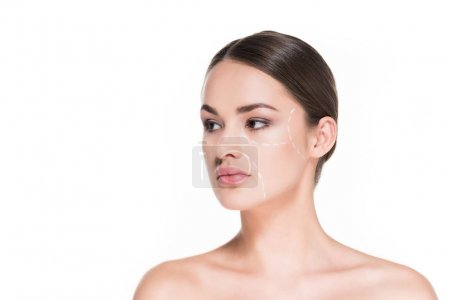 Photo for Beautiful young woman with dotted line drawn on face for plastic surgery isolated on white - Royalty Free Image