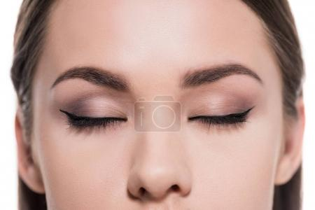 cropped shot of young woman with beautiful eyes makeup isolated on white