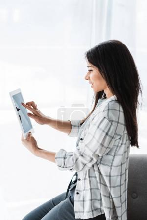 Pretty african american girl using digital tablet
