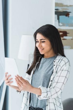Pretty woman looking at digital tablet screen