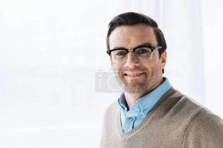 Smiling attractive man wearing browline glasses
