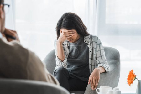 Upset african american woman in office of male psychologist