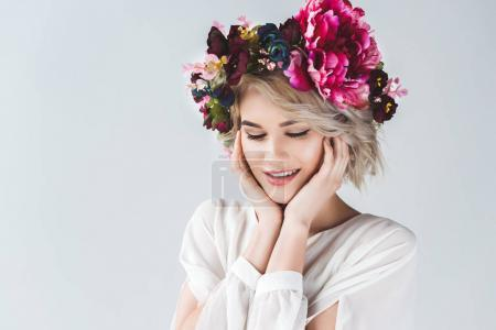 Photo for Happy tender girl posing in flower wreath, isolated on grey - Royalty Free Image