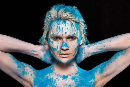 young blonde woman in blue powder powder, isolated on black