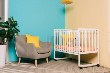 Photo for Interior of retro styled bright child room with wooden cot - Royalty Free Image
