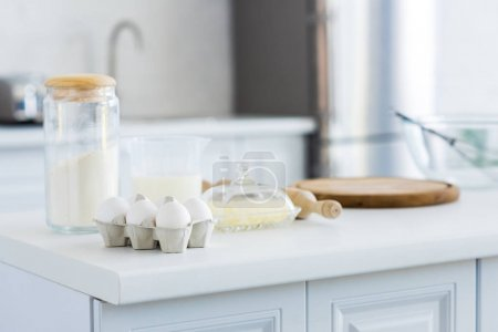 Photo for Rolling pin, cutting board and eggs on kitchen counter - Royalty Free Image