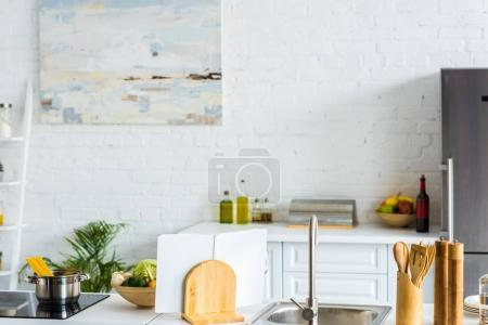 Photo for Interior of modern light kitchen with paint on wall - Royalty Free Image