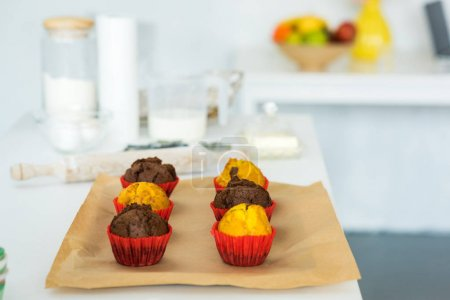 Photo for Delicious cooked muffins on tray in kitchen - Royalty Free Image