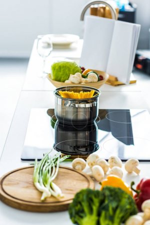 pasta in pan on electric stove in kitchen