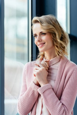 Photo for Beautiful thoughtful woman in pink blouse and jacket looking away - Royalty Free Image