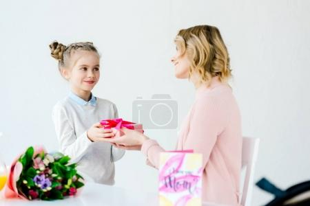 cute little daughter greeting mother with mothers day