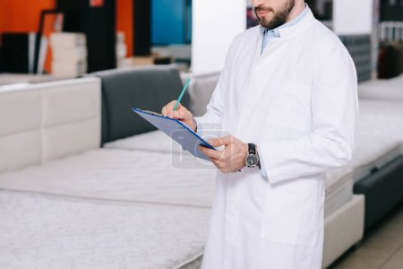 Assistant in white coat