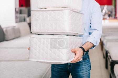 pile of folding mattresses