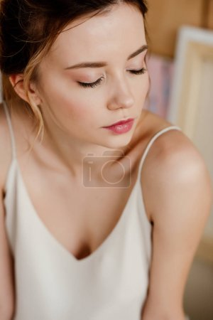 close-up portrait of beautiful young tender woman with closed eyes