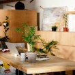 Interior of artist studio with painting supplies, ...